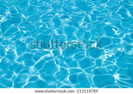 turquoise swimming pool surface water and waves  - stock photo