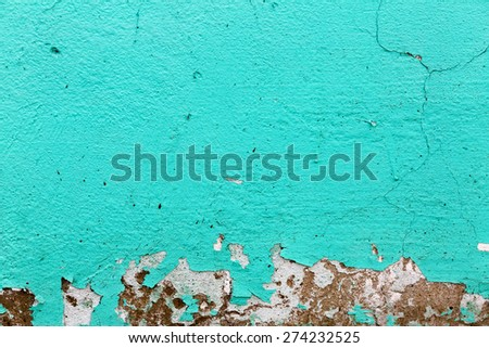 Turquoise texture. Peeling paint background.  A fragment of the old wall, painted bright turquoise paint, cracked over time.  - stock photo