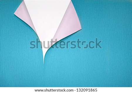 turquoise wallpaper with curled corner and white copyspace - stock photo