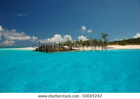 Turquoise water against blue sky - stock photo