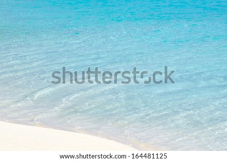 Turquoise water and white sand. - stock photo
