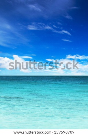 turquoise water of the ocean and blue sky - stock photo