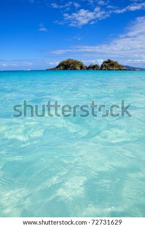 turquoise water of trunk bay, us virgin islands, focus on water in foreground - stock photo