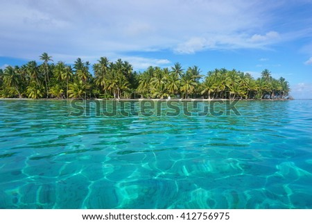 Turquoise water with tropical islet, Huahine island, Pacific ocean, French Polynesia - stock photo