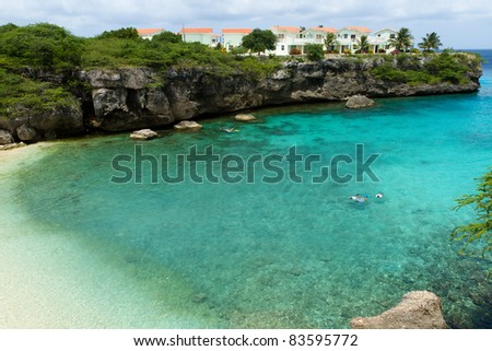 Turquoise waters of a cove in Curacao - stock photo