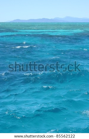 Turquoise waters of the Great Barrier Reef off the coast of Queensland Australia - stock photo