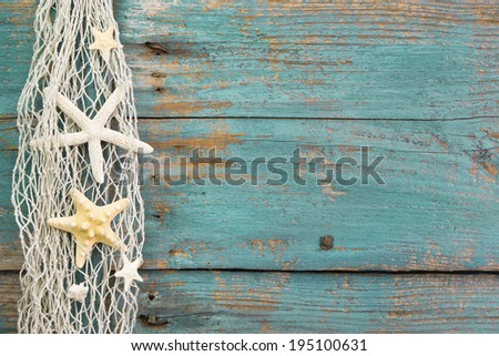 Turquoise wooden background with starfish - maritime decoration. - stock photo