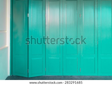turquoise wooden front door to the house, classic colonial old building style