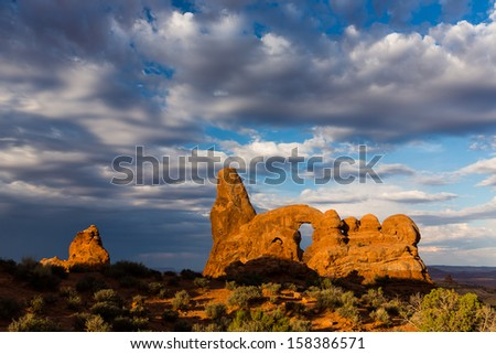 Turret Arch Under Stormy Clouds Arches National Park