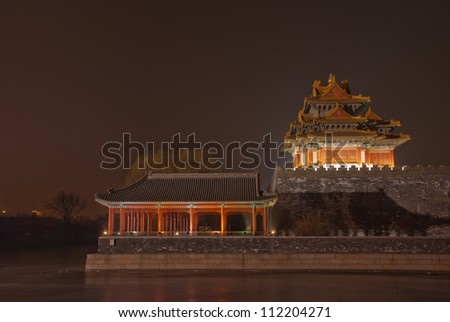 turret of the palace museum at night in beijing,China