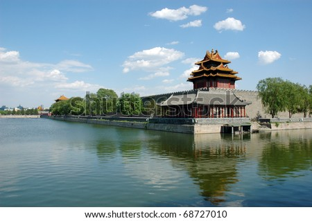 Turret, wall and their reflections on moat in the northwest corner of the forbidden city, Beijing China.