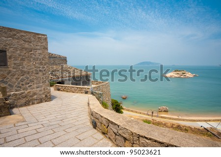 Turtle island seen from an elevated viewpoint in the preserved stone village of Qinbi, the top tourist destination for the Matsu islands in Taiwan - stock photo