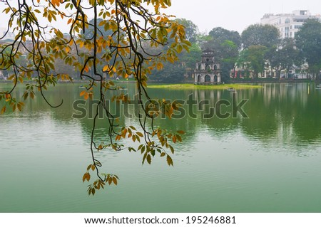 Turtle tower in Sword lake in Hanoi, Vietnam - stock photo