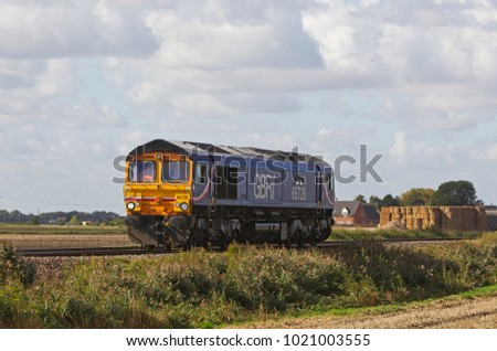 TURVES, UK - SEPTEMBER 25: A GBRf operated loco heads toward a local freight depot to pick up its next working on September 25, 2015 in Turves. Founded in 1999 GBRf operates a fleet of 120 locos