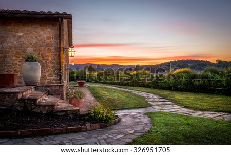 Tuscan countryside with amazing sunset in the background - stock photo