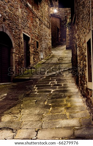 tuscan dark alley at night, narrow dirty corner of street in the old village of tuscany - stock photo