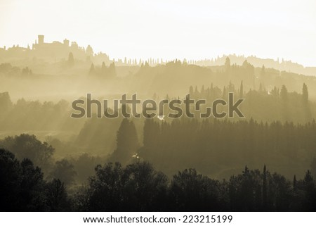 Tuscan landscape at dusk, Italy - sepia tone image - stock photo