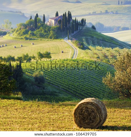 Tuscan Morning countryside. Farmhouse and hills - stock photo