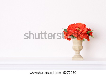 Tuscan Style Vase with Orange Decorative Flowers - stock photo