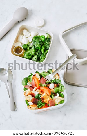 Tuscan tomato & bread salad with parma ham in a lunchbox - stock photo