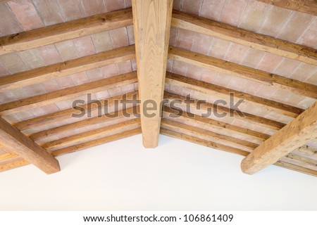 Tuscan traditional oak wood beam ceiling, red bricks pattern and wall on background. Classic italian rural interiors. - stock photo