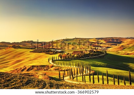 Tuscany, Crete Senesi rural sunset landscape. Countryside farm, cypresses trees, green field, sun light and cloud. Italy, Europe. - stock photo