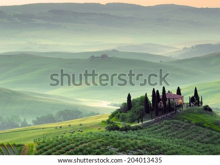 Tuscany, farmhouse and green hills - stock photo