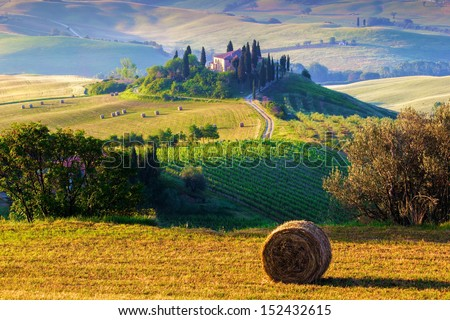 Tuscany, farmhouse and landscape on the hills of Val d'Orcia - Italy - stock photo