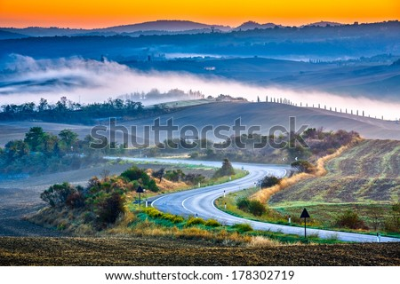 Tuscany foggy landscape at sunrise, Italy - stock photo