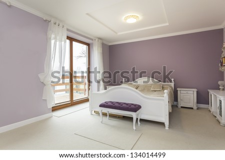 Tuscany - interior of purple bedroom with white furniture - stock photo