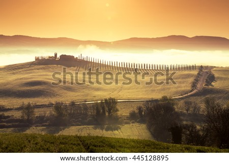 TUSCANY, ITALY - APRIL 11, 2016: Tuscan countryside in Val d Orcia at morning light, Tuscany, Italy - stock photo