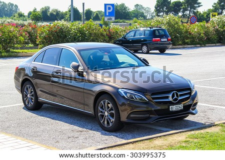 TUSCANY, ITALY - AUGUST 1, 2014: Motor car Mercedes-Benz W205 C-class at the interurban road. - stock photo