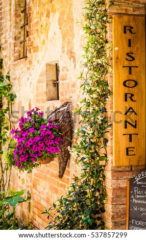 Tuscany, Italy. Sightseeing of Italian Restaurant in traditional small village in Val Orcia