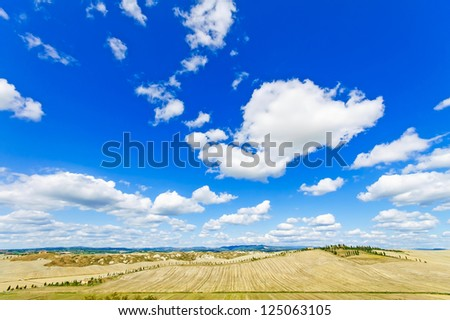 Tuscany landscape, Aerial panoramic view on fields and trees in Crete Senesi land near Siena, Tuscany, Italy, Europe. - stock photo