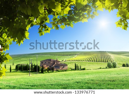 Tuscany landscape with typical farm house - stock photo