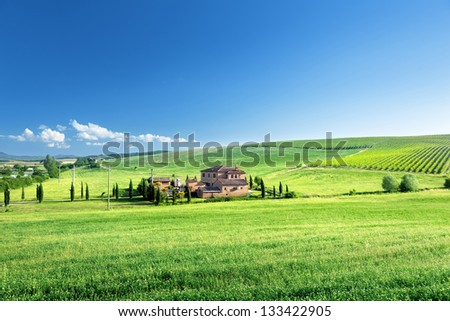 Tuscany landscape with typical farm house, Italty - stock photo