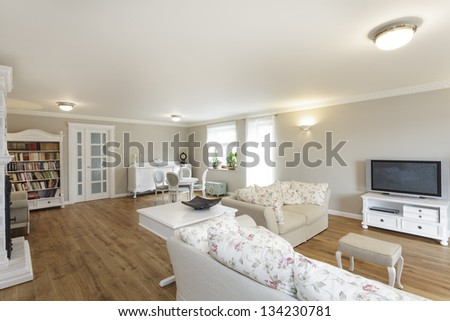 Tuscany - living room with white sofa and bookcase - stock photo