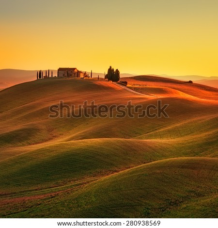 Tuscany, rural landscape in Crete Senesi land. Rolling hills, countryside farm, cypresses trees, green field on warm sunset. Siena, Italy, Europe. - stock photo
