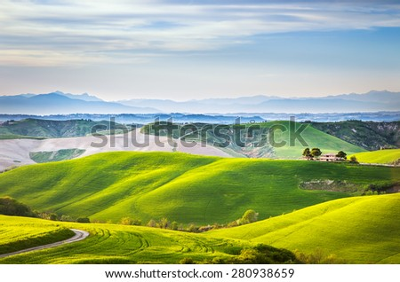 Tuscany spring, rolling hills on sunset. Volterra rural landscape. Green fields and farmland. Italy, Europe - stock photo