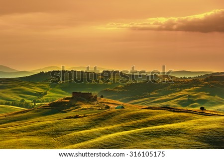 Tuscany spring, rolling hills on sunset. Volterra rural landscape. Green fields and farmland. Italy, Europe