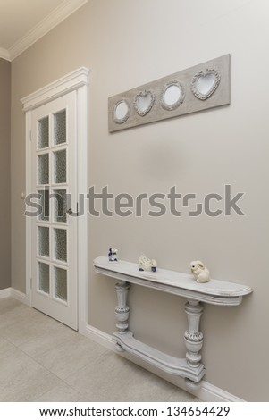 Tuscany - white wooden shelf in corridor - stock photo