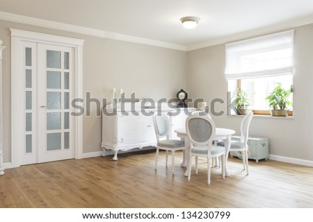 Tuscany - White wooden table and chairs - stock photo