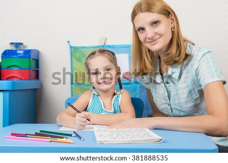 Tutor and five year old girl engaged in spelling - stock photo