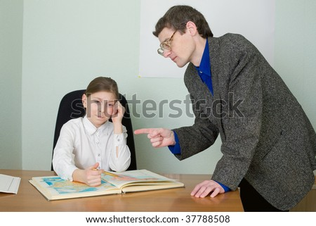 Tutor in a suit and schoolgirl with atlas - stock photo