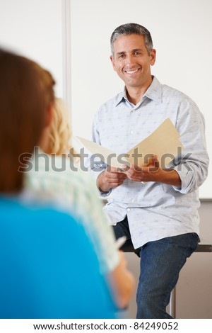 Tutor with class of students - stock photo