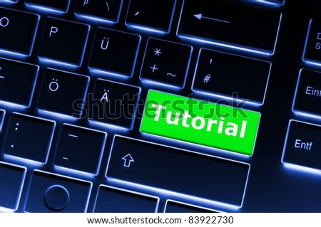 tutorial key with word showing internet or online software education concept - stock photo