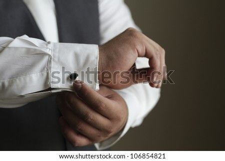 Tuxedo / Standing groom in a gray tuxedo vest. Image was taking during a wedding. - stock photo