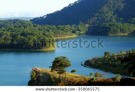 Tuyen Lam lake at Dalat, Vietnam, beautiful landscape for eco travel at Viet Nam, amazing lake among pine forest make wonderful scene, boat on water, Da Lat countryside is famous place for holiday