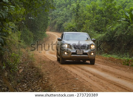 Tuyen Quang, Viet Nam - April 23, 2015: Nissan NP Navara running on the dirt road in Vietnam
