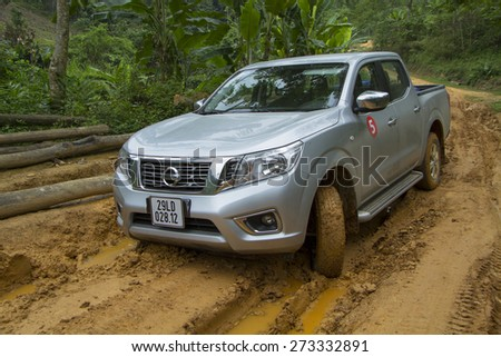 Tuyen Quang, Viet Nam - April 23, 2015: Nissan NP300 Navara running on the mud road in Vietnam